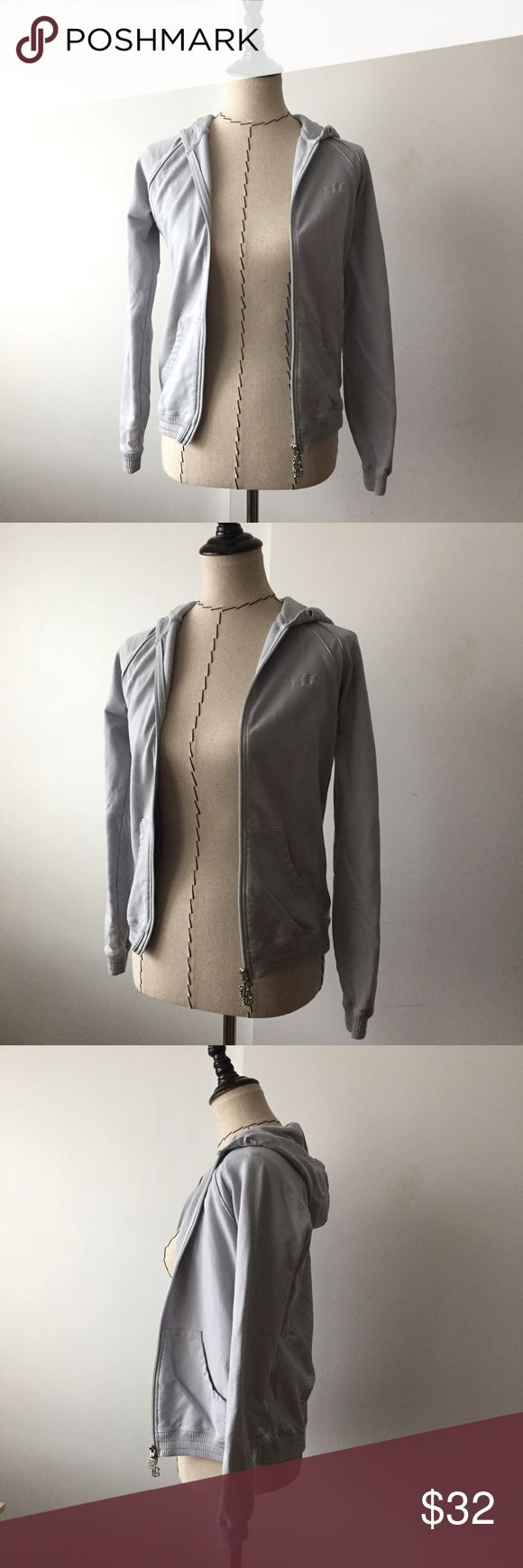 BCBG grey zip up hoodie jacket 95 cotton, 5 spandex. Missing ties for the hoodie but other than that great condition. Zips in the front and has two pockets. Detailing on the back as shown in photo. BCBGMaxAzria Jackets & Coats