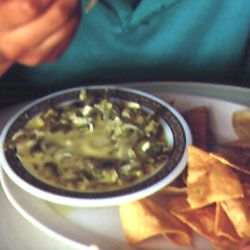 Also known as Rajas con Crema, I use heavy cream instead of sour cream.  This is my favorite recipe for this dish, fabulous wrapped in tortillas.  And it's a super side dish for fajitas!  Chile con Queso Recipe - Saveur.com