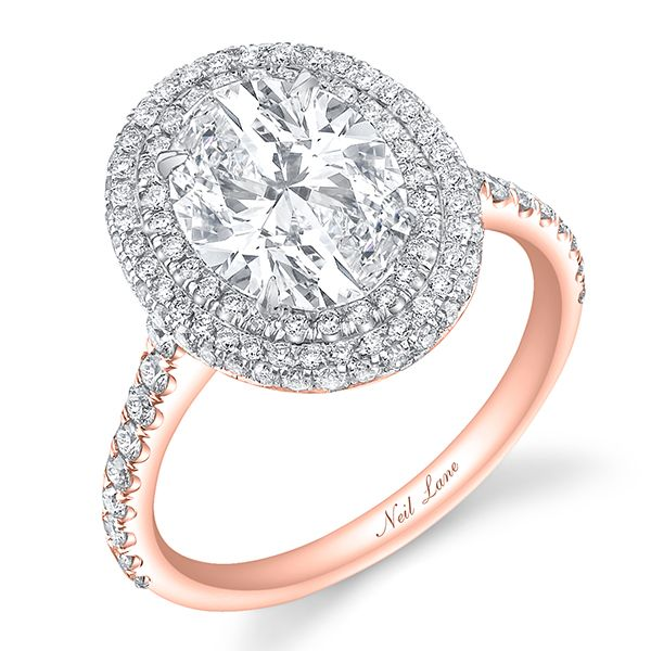 This triple-tier oval diamond ring by Neil Lane is set in both rose gold and platinum.Related: Mixed Metal Engagement Rings