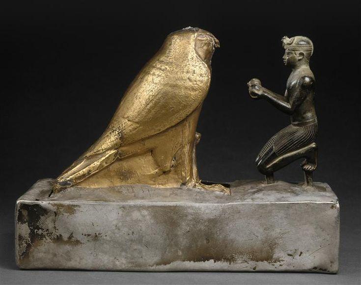 Statue of Taharqa offering wine to the falcon god Hemen