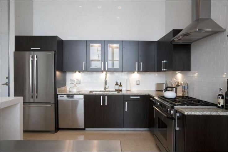 Espresso Kitchen Cabinets With White Subway Tile Backsplash