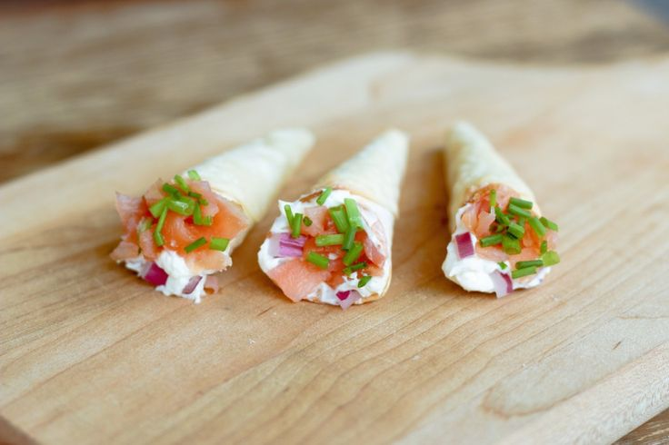 Smoked Salmon Cornets - made with wonton wrappers, cream cheese, onion, chives and smoked salmon.  Easy peasy.
