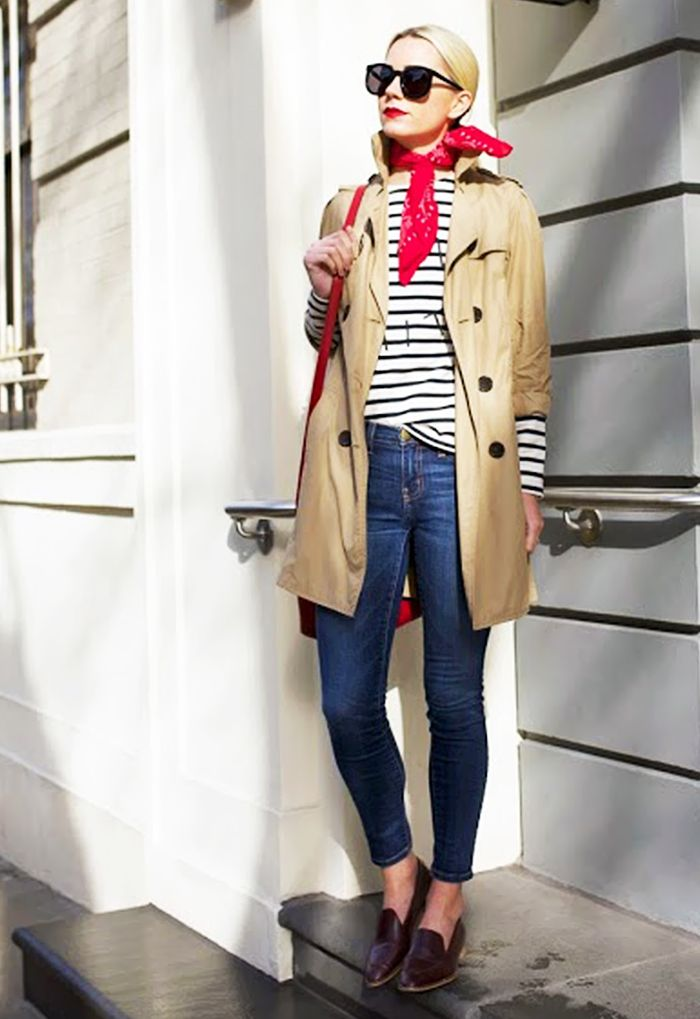 Striped shirt, trench coat, skinny jeans, and loafers