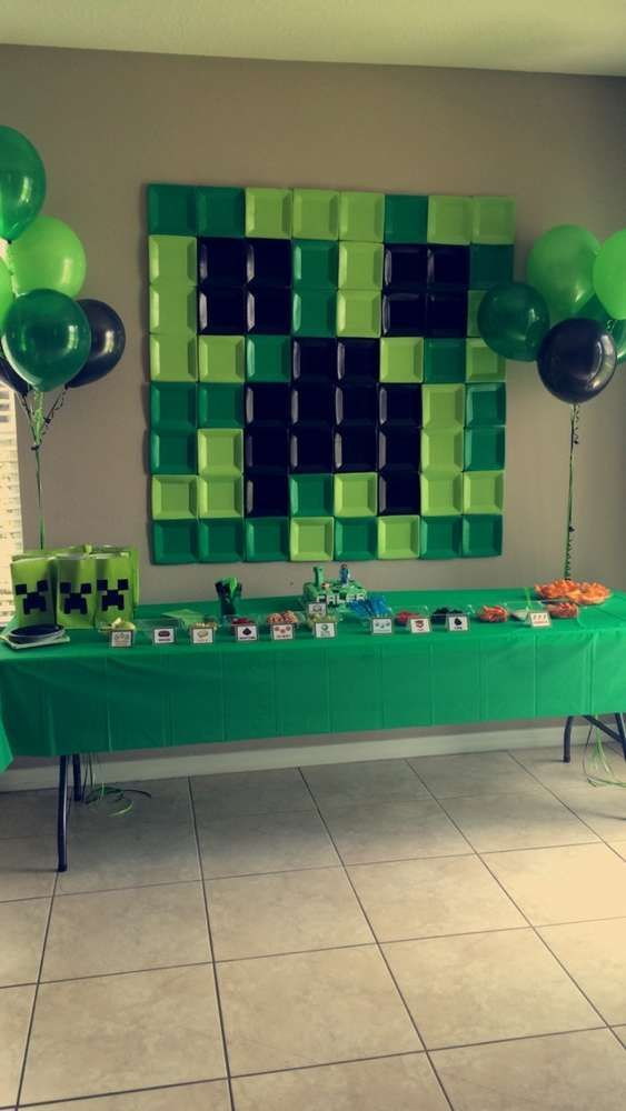 Square paper plate backdrop at a Minecraft birthday party! See more party planning ideas at CatchMyParty.com!