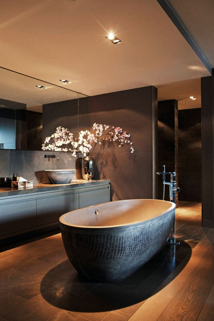 Elegant black bathroom with a fake snakeskin bath for extra drama.