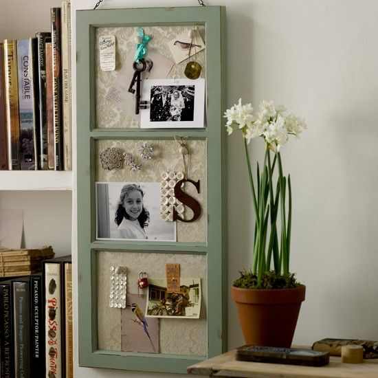 Window frame with cloth covered cork makes a wonderful display area.  Definitely going to do this!