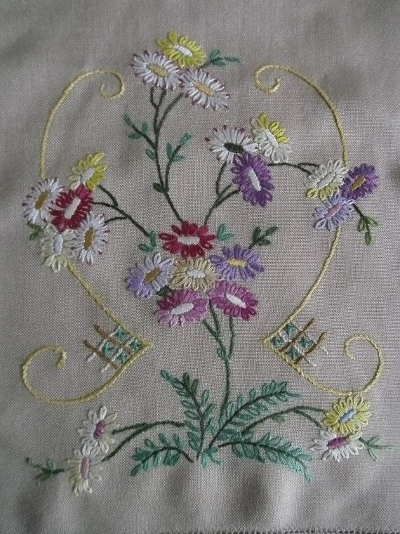 Table runner measures 95x27.5cm and has the most wonderful hand embroidered flowers at each end