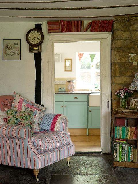 country cottage bookshelves above door.