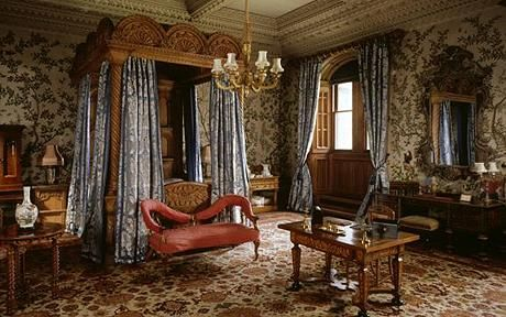 The State Bedroom at Penrhyn castle is covered with late-18th century hand-painted Chinese wallpaper. UK.