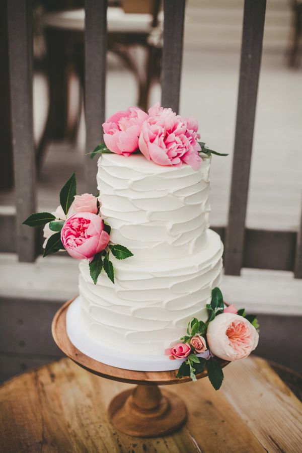 wedding cake with peonies - photo by Melissa Biador http://ruffledblog.com/mixed-metals-wedding-in-la-jolla