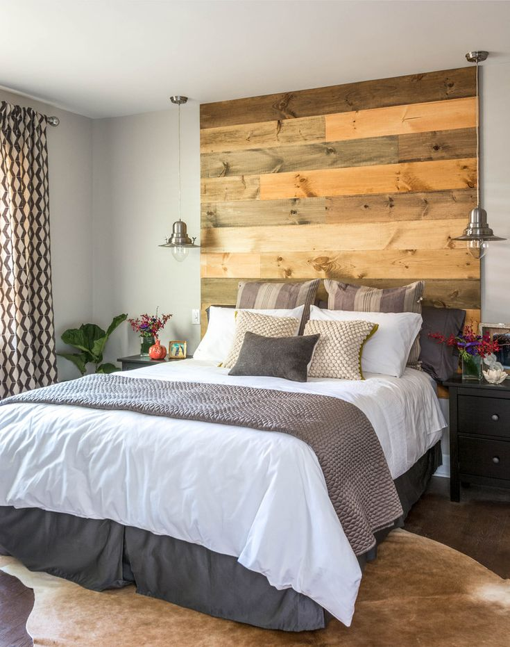 Contemporary bedroom with reclaimed wood headboard, cowhide rug, stainless steel pendant lighting, white and grey bedding | Carriage Lane Design-Build Inc.