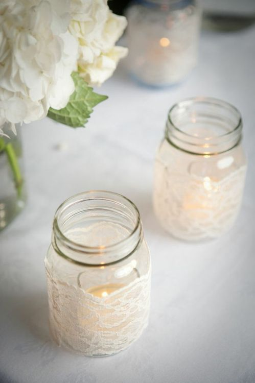 Lace-wrapped mason jars. Cute for little center pieces on the table for an intimately lighted room. Cheap and easy, too.