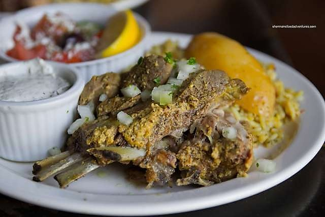 """Lamb shoulder slow roasted in a lemon & mustard sauce. So tender it'll """"cut with a fork"""". Served with rice and/or roasted potatoe, Greek Salad, tzaziki & pita bread."""