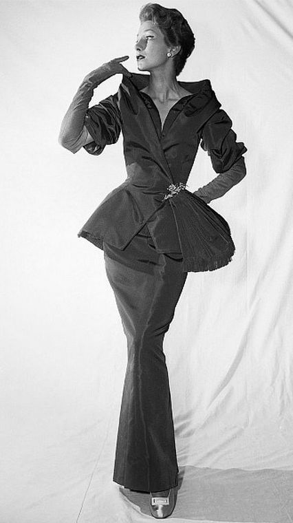 1954 Dior rose-beige faille evening ensemble, jacket has stand-away shawl collar over a narrow dress that tapers to a narrow hobble skirt