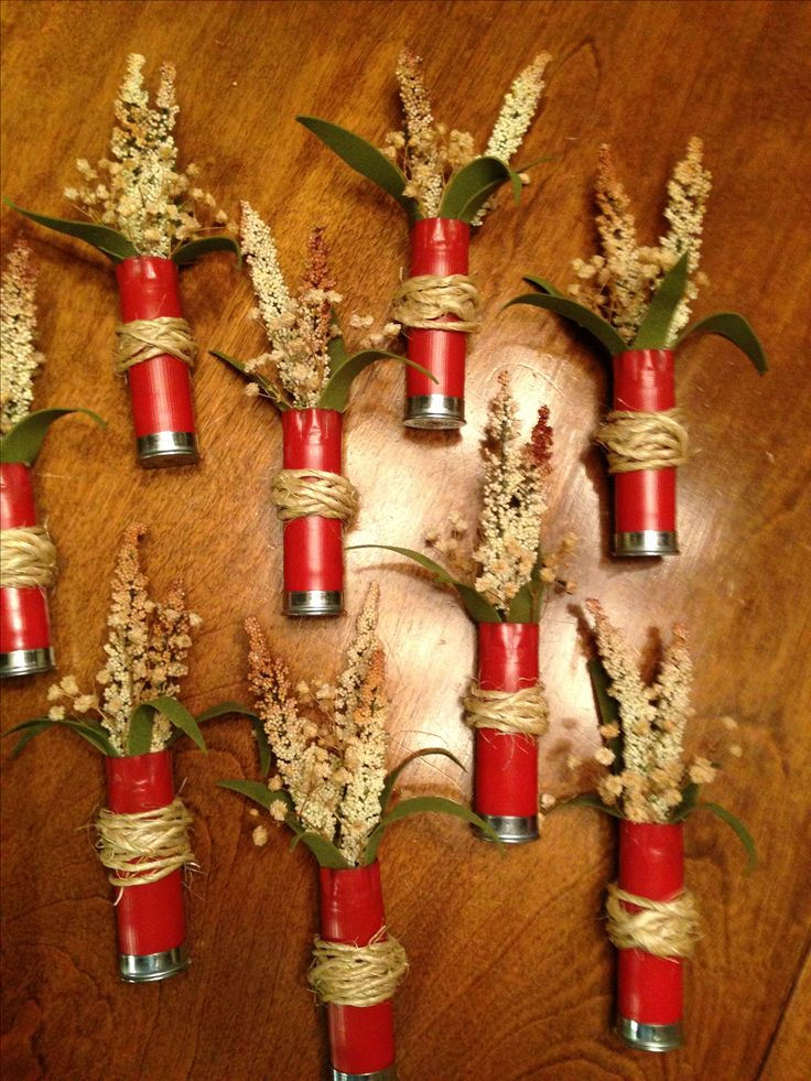 Shot gun shell Boutonniere.  These are some nicely done boutonnieres found online.  Get your shells today for your very own DIY project.