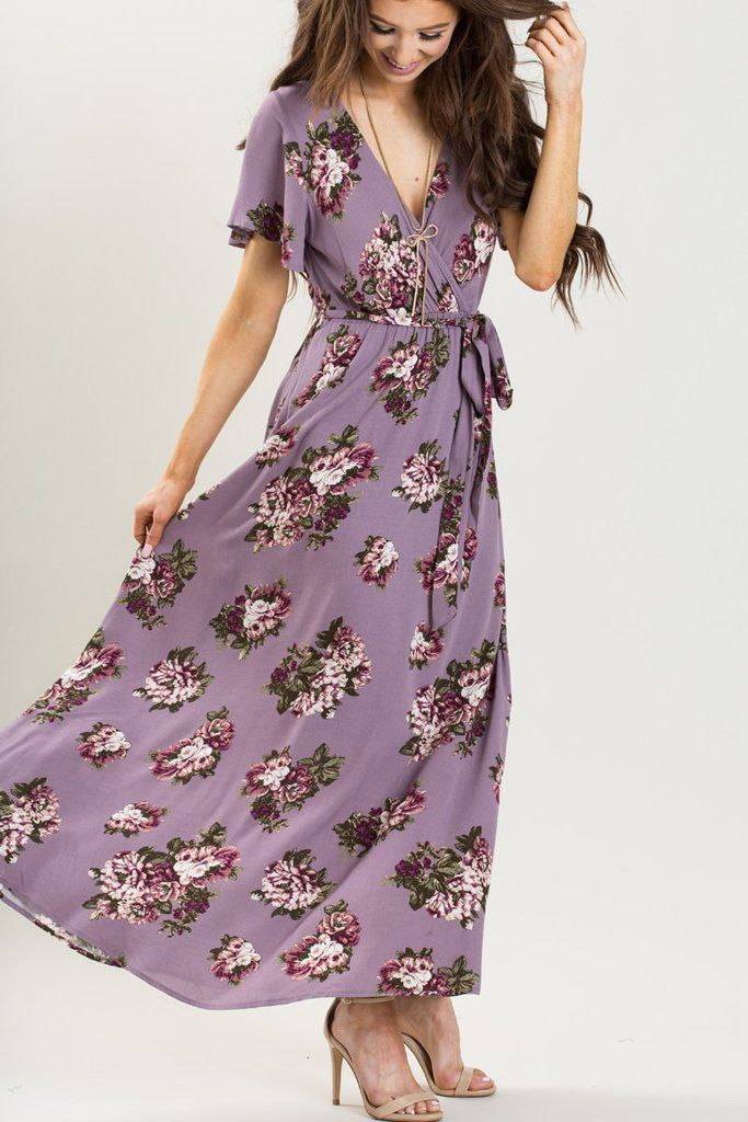 We love floral dresses and this gorgeous purple maxi wrap dress is no exception! The must have color is perfect...