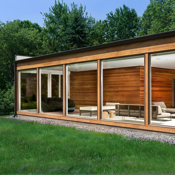 Jeff Jordan Architects has renovated a mid-century home in New York's Hudson Valley with a fully glazed wall, white flooring and cedar walls.