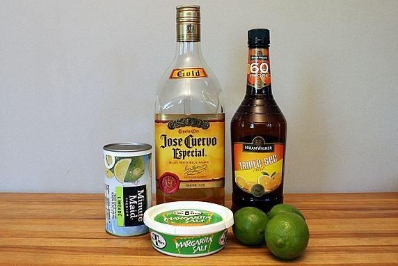 Make-Ahead Frozen Margaritas  Servings: 6-7 servings  Ingredients  1 (12 oz.) can frozen limeade concentrate  1 cup (8 oz.) tequilla  1/4 cup (2 oz.) triple sec (orange flavored liqueur)  juice of 2 limes (plus a lime for garnish)  4-5 cups ice  kosher salt or margarita salt (it's more coarse than table salt)