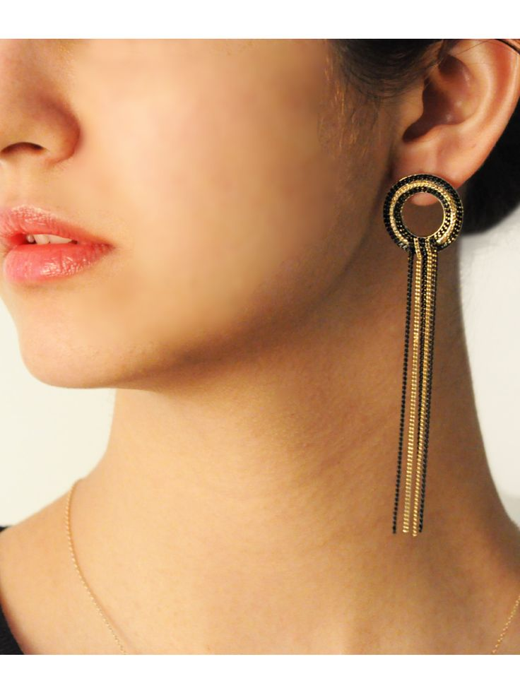 Lava Hoop & Tassel Earrings -  INR 1,199 -  These drop earrings feature a mixed metal finish in Gold and black link chains. The top of the earrings have a round hoop with long link tassels suspended. These are perfect for a night out.