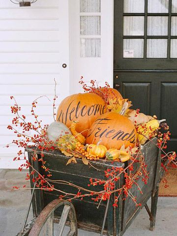 I like this idea...writing 'welcome' on the pumpkins...but for me, I would use hay bales instead of the wheelbarrow. Plus, I don't have room for a wheelbarrow on my front porch.