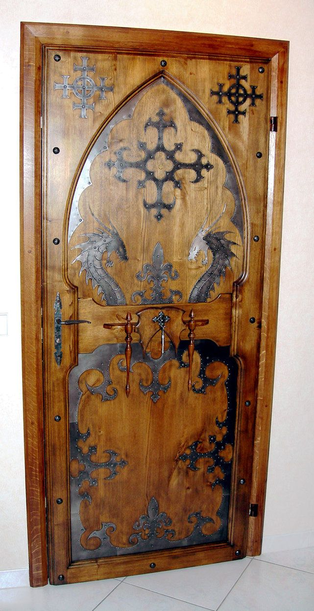 """Scandinavian Door w/old style / or old designs / dragons -- the symbol on the upper right and left may be what I saw in a few Stave Kjirke's which had a MEANING of saying """"WE ARE HERE, BUT WE DON'T BELIEVE THIS"""" because Christianity was ENFORCED. by King Richard I think -- It was Mandatory."""