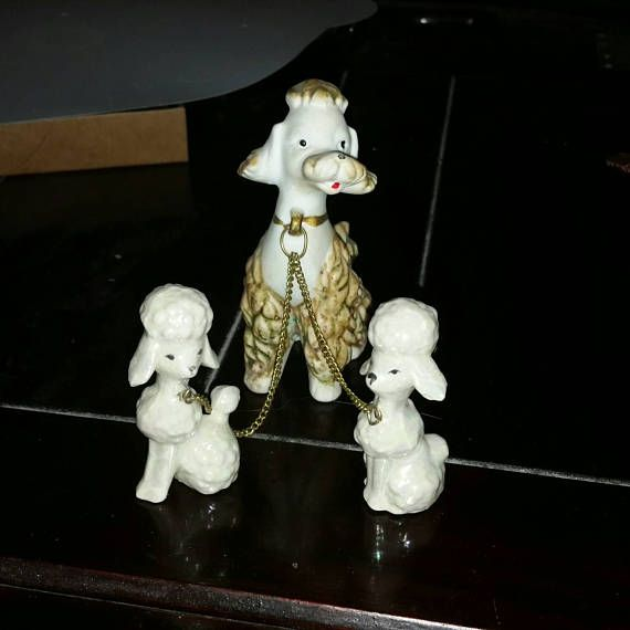 Check out this item in my Etsy shop https://www.etsy.com/ca/listing/528938751/vintage-chained-poodle-family-figurines