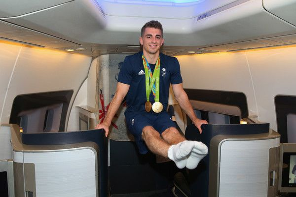 Max Whitlock of Great Britain poses with his medals during the Team GB flight back from Rio on British Airways flight BA2016 on August 22, 2016 in Rio de Janeiro, Brazil.