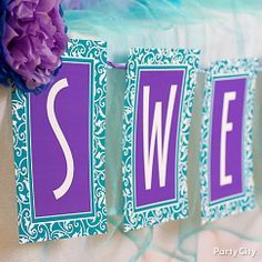 DIY a sweet party garland in blue & purple – it's a candy table banner that's pure eye candy! Click through for the how-to.