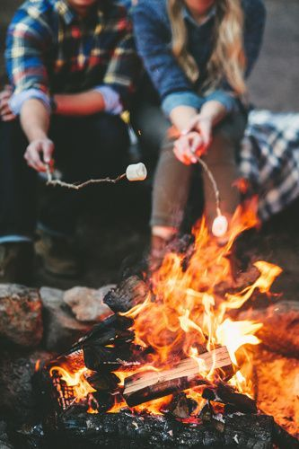 Roasting marshmallows around the fire on a crisp autumn evening