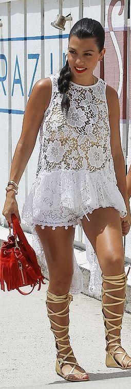 Who made  Kourtney Kardashian's gold gladiator sandals, red fringe handbag, and jewelry?