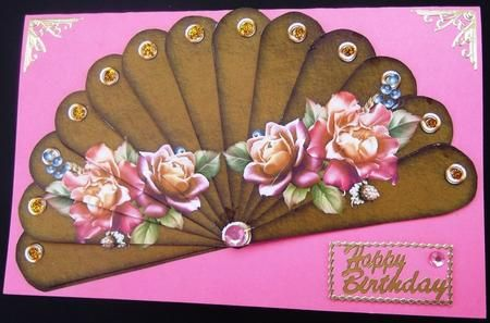 Autumn Roses   Happy Birthday   Just Because   Fan Sheet on Craftsuprint created by Hilda Mullinger - This pretty design is printed on white card and cut out. I used a pink card which matches the roses and glued the fan into place. Then attached each blade in numerical order, by turning each blade face down, with the thin end at the bottom, and putting 3 small blobs of silicone glue on the left side only and putting it into position. I finished off with gold peel offs.