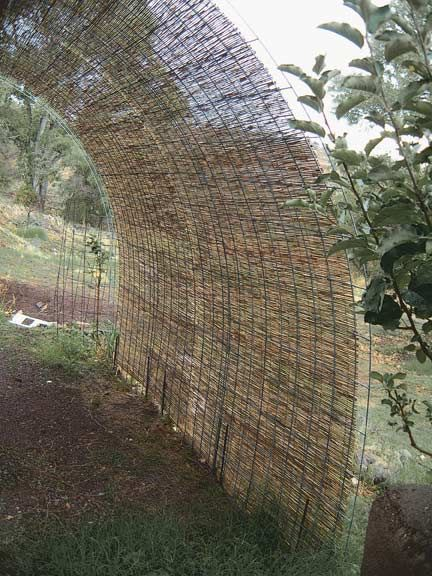 Shade screen made by laying reed mats over prefab livestock panels used for fencing. Could also use Bamboo roll fencing.