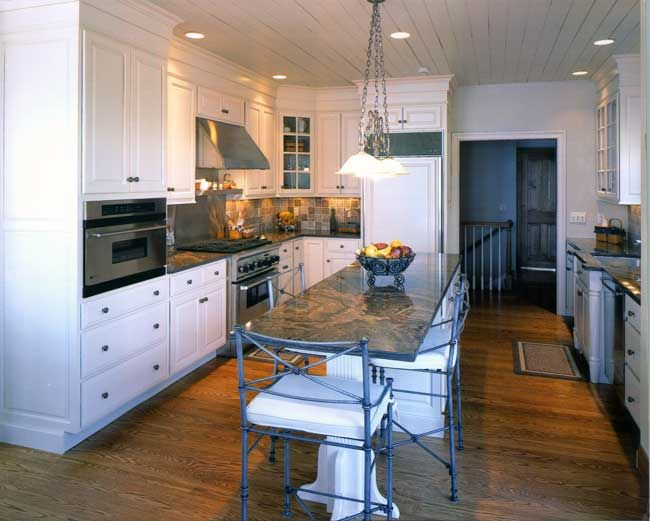 Transitional white kitchen, stacked crown molding, wood floors and ceiling