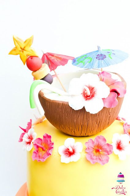Gum paste coconut cocktail with hibiscus flowers and fruits