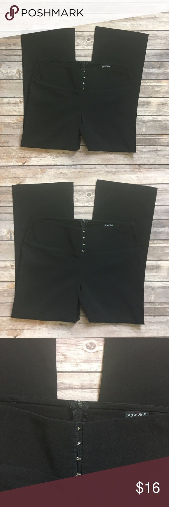 """Paper doll black capri cropped dress pants Paper doll black capri cropped dress pants. Adorable silver clasp front and zipper in back. No pockets, super sleek style. Excellent used condition, no flaws. Measurements: 15"""" waist, 25"""" inseam, 9.5"""" inseam  Bundle & save!  Reasonable offers accepted. I ship the same or next day! No trades/off app sales From a smoke free home Paper Doll Pants Trousers"""