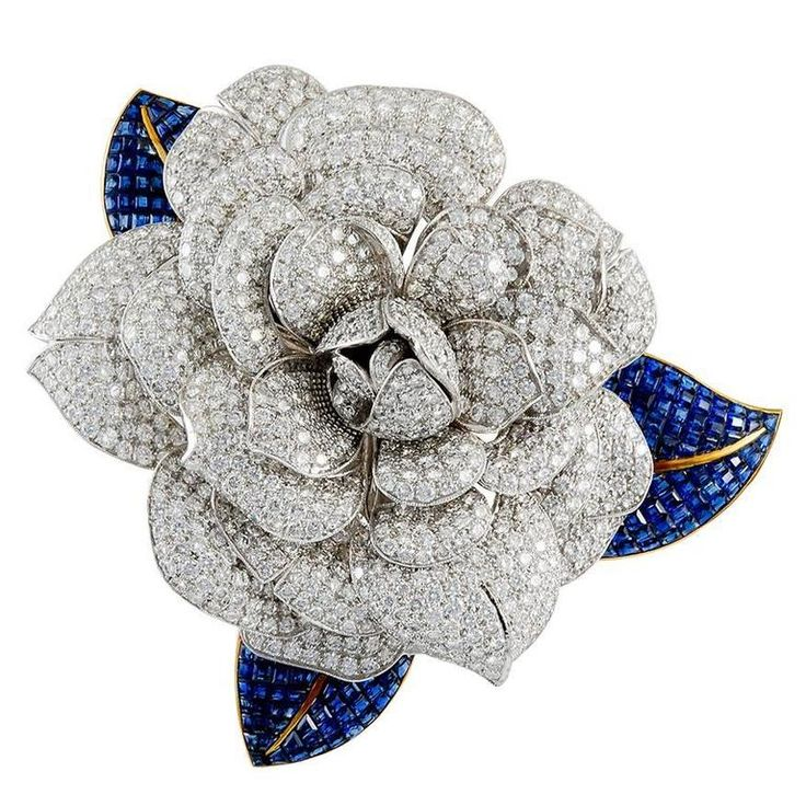 Diamond and Sapphire Camellia Brooch | From a unique collection of vintage brooches at https://www.1stdibs.com/jewelry/brooches/brooches/