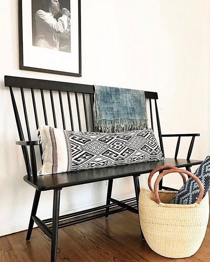 Boasting solid wood construction and a black finish, our Kamron High Back Windsor Bench expands on traditional Windsor chair design with a high cap-railed spindle back and armrests. Photo credit: @homegirlcollection #WorldMarket #HomeDecor World Market (@worldmarket) on Instagram