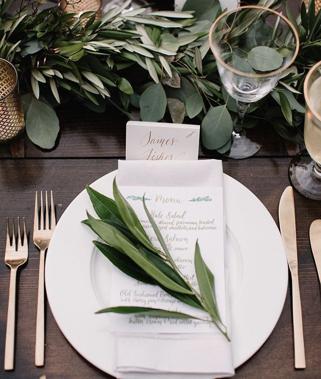 This surely is a place-setting we'd love to sit at! From the Gold rimmed glassware and gold flatware, to the stark white china, green eucalyptus #garland, and the #goldlettered calligraphed #escortcard — this #weddinginspo will inspire all your #gardenwedding dreams! xoxo @sp_ackerwoman + @ackermanct. photo: @gregbalkin via @beinspiredpr, venue: @cheekwoodevents, hair & makeup: @krbeauty, catering: @flavorcatering, rentals: @southerneventsonline, @libertypartyrental, @musiccitytents
