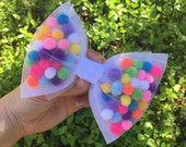 Items similar to Girl Pom Pom Hair Bow, Girl Hair Bow, Girl Headband, Baby Bows, Infant Headband, Toddler Bows, Fun Hair bows, Colorful Bows, Cream Hair bows on Etsy