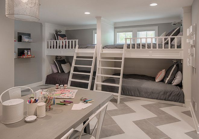 Basement bunk room and craft room area. Chevron flooring is ceramic tile. Grey…
