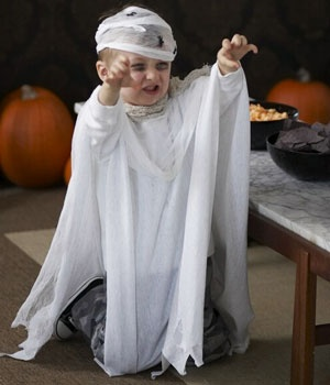 ghost costume- wrap white gauze around her head or use a white hat.