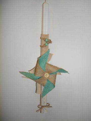 Handmade Easter candle decorated with fiber item..