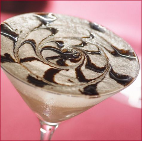White Chocolate Raspberry Martini: 2 parts Vanilla Vodka, 1 part Chambord (Black Raspberry Liqueur), 1 part White Chocolate Liqueur, splash of heavy cream, and chocolate syrup. Yum!