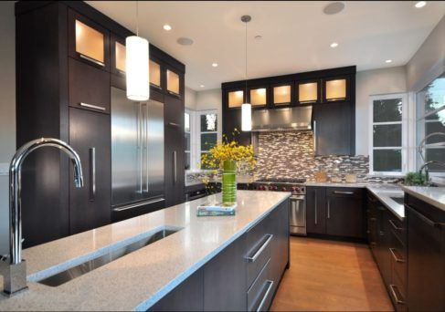Modern Kitchen with trough sink, stainless appliances, clear story glass cabinets and Quartz counters.