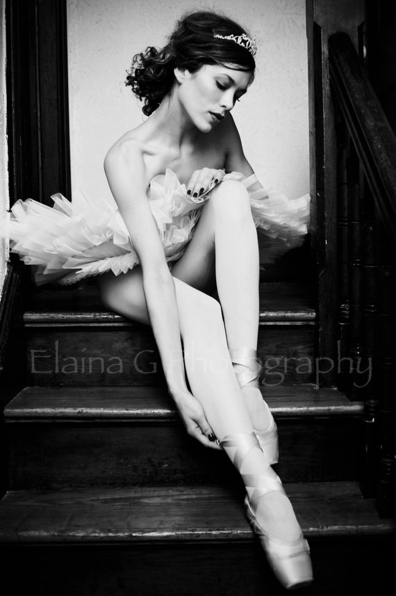 Ballerina? Pretty woman, but look at the ribbons... Dead give away. Plus the whole pose.
