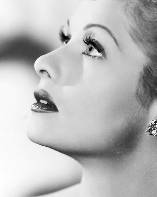 Lucille Ball.... Now imagine taking this photo and then having another photo pinned slightly above it with your significant other glancing down at you. So doing this!