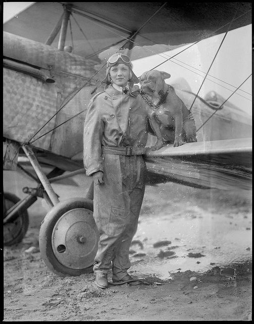 Title: Mrs. Dorothy Warrick, a student at East Boston Airport. From  Pittsburg, PA. Wife of a Teck student flies with Hargenhaig, her 13  blue ribbon English bulldog. Creator/Contributor: Jones, Leslie, 1886-1967 (photographer) Date created: 1928-05-27