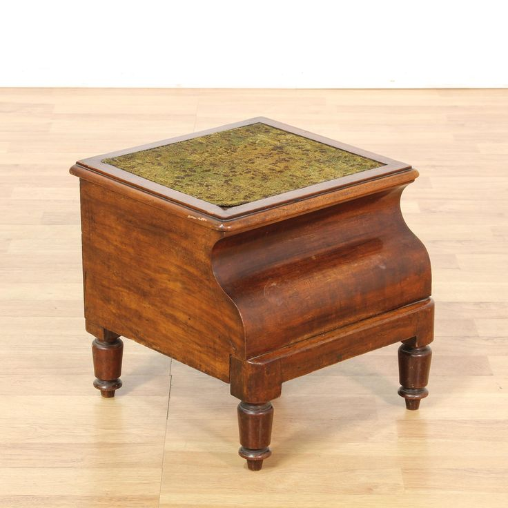 This antique early American chamber pot stool is featured in a solid wood with a glossy mahogany finish. This vintage potty commode has a lift up fabric upholstered top with a interior hole for a chamber pot and turned feet. Adorable and unique bed side stool perfect for an antique collector's space! #americantraditional #decor #accents #sandiegovintage #vintagefurniture