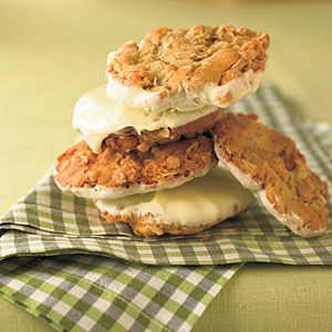 Crunchy Frostbite Cookies...crispy oatmeal cookies dipped in melted white chocolate for a frosted look