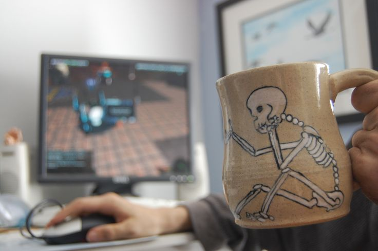 Gamers and the beverage of choice in a unique skeleton mug ftw. http://www.reannagteine.com/Products/MacabreDancer.html